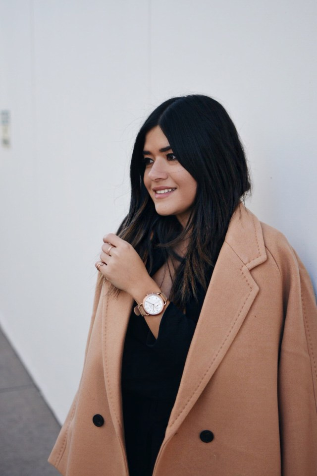 Carolina Hellal of Chic Talk wearing a Fossil Q hybrid smartwatch