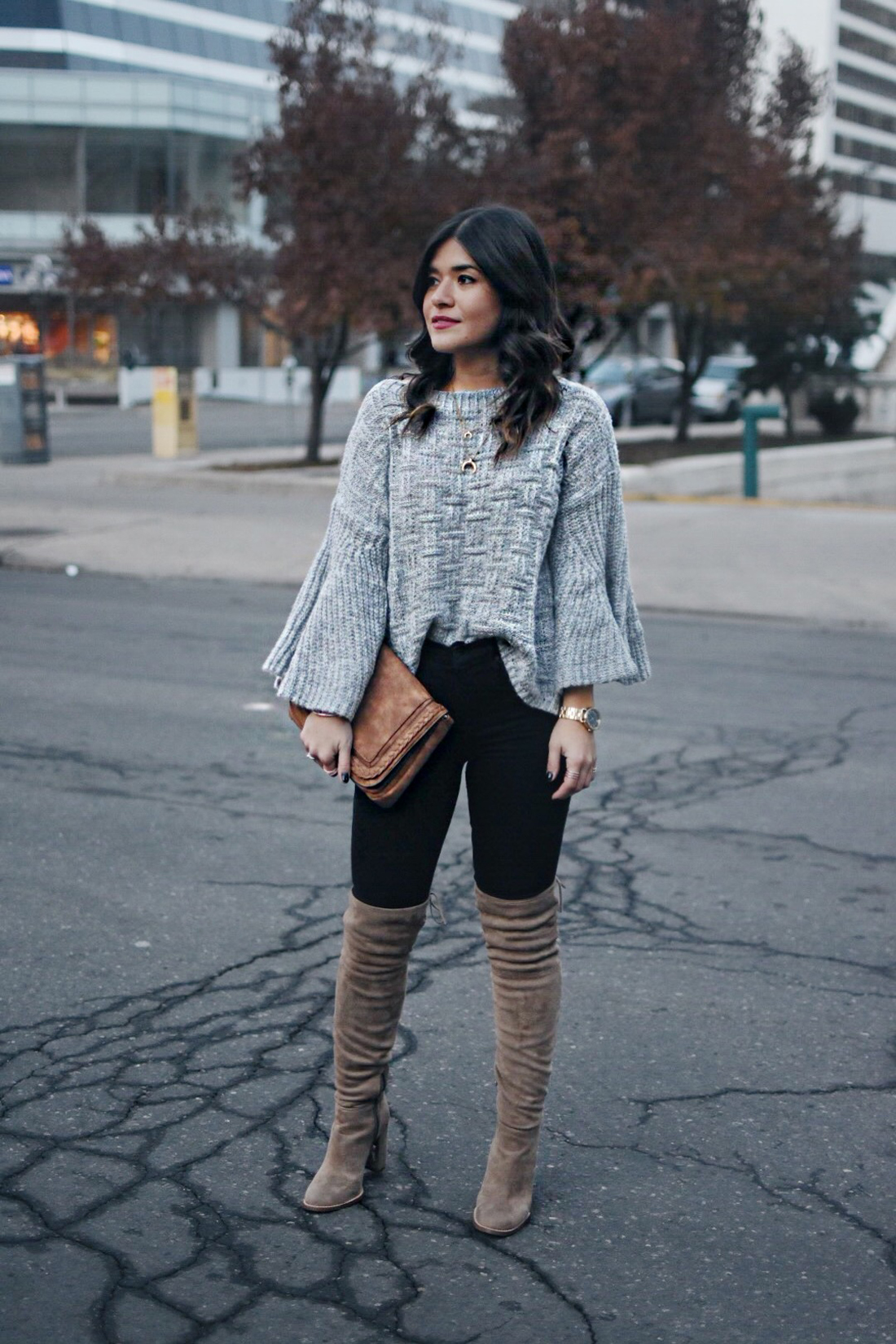 Carolina Hellal of Chic Talk wearing  Shein Grey sweater, black jeans and Vince Camuto over the knee boots.