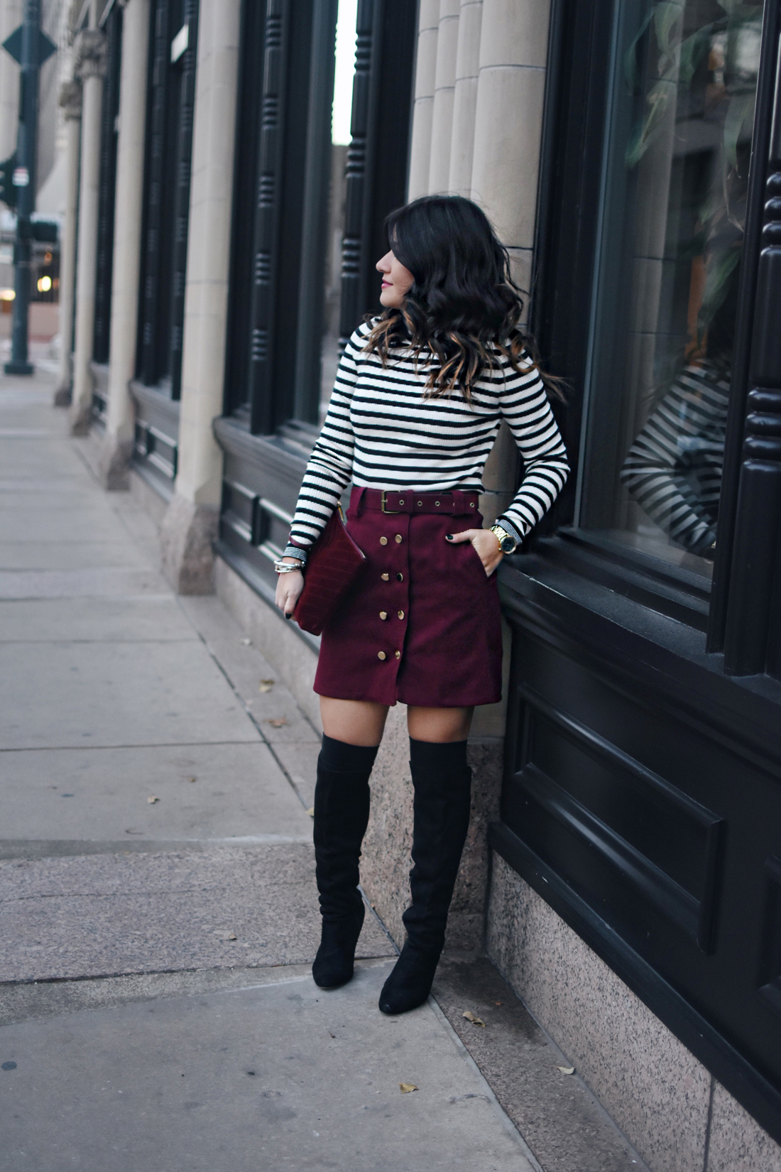 Carolina Hellal of Chic Talk wearing a burgundy mini skirt, gap stripped sweater and black over the knee boots