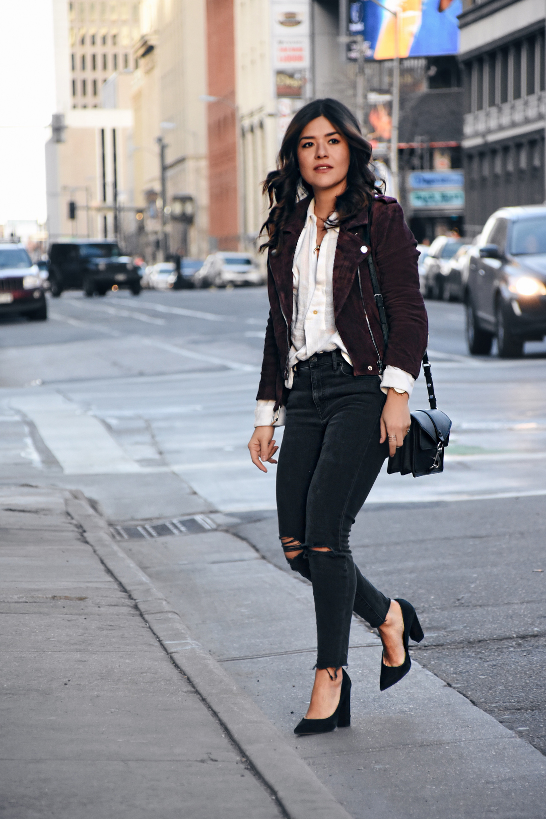 Carolina Hellal of Chic Talk wearing a Suede jacket, free people top, Madewell jeans, Rebecca Minkoff bag, and Sam Edelman shoes