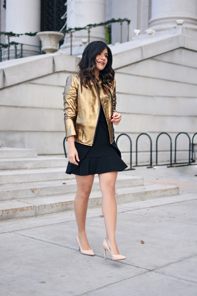 Carolina Hellal of Chic Talk wearing a gold faux leather jacket via Thacker NY