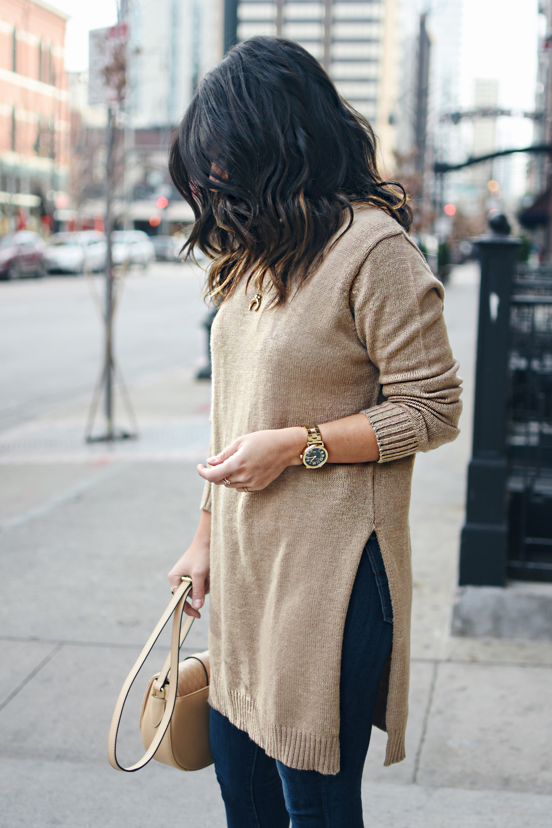 Carolina Hella of Chic Talk wearing a NA-KD sweater, Marc Jacobs watch and Paige jeans