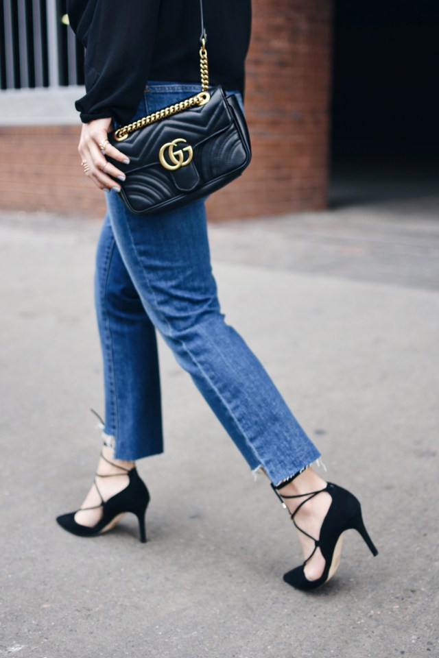 Carolina Hellal of Chic Talk wearing a Gucci Marmont bag, Madewell jeans, Forever 21 crossfront black top and Aldo black lace up pumps