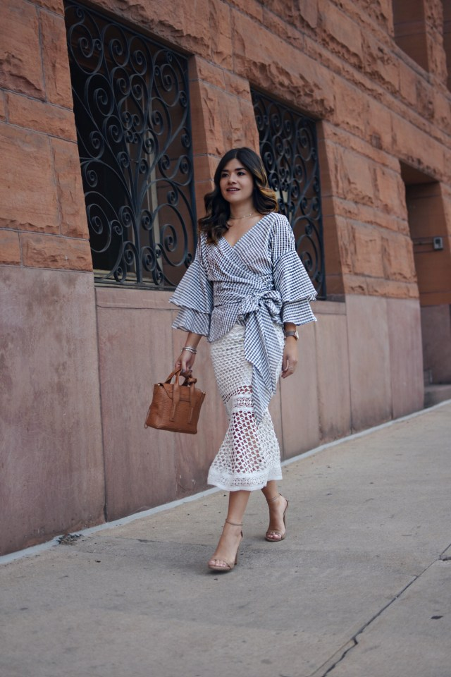 Carolina Hellal of Chic Talk wearing WAYF crossfront top via Nordstrom, a Chiwish white midi skirt, Phillip Lim bag, Steve Madden strap sandals.