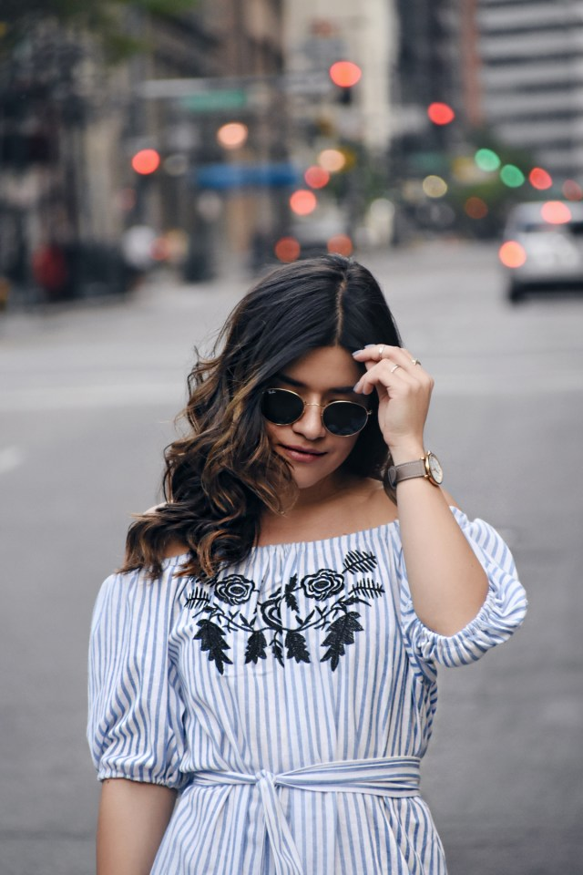 Carolina Hellal of Chic Talk wearing an off the shoulder shein dress, rayban sunglasses, marc jacobs watch and rebrecca minkoff shoes