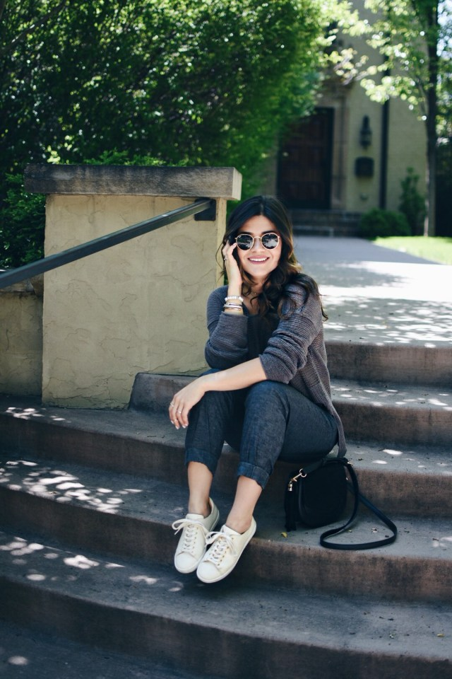 Carolina Hellal wearing PrAna pants and sweater and Sezane tennis shoes.