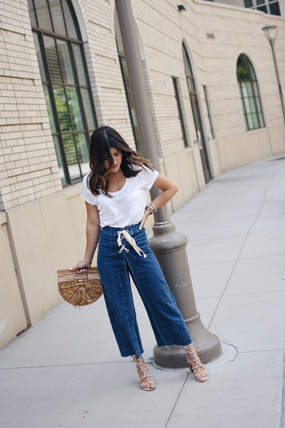 Carolina Hellal of Chic Talk wearing Topshop deni culottes, H&M basic t-shirts, Cultgaia ark bag and Rebecca Minkoff bag
