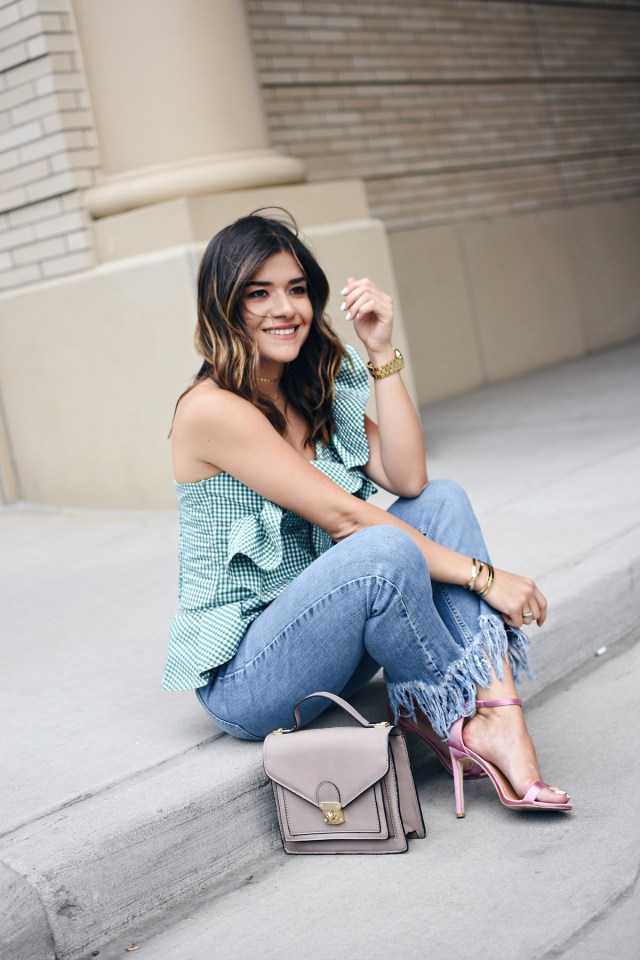 Carolina Hellal of Chic Talk wearing a gingham green top via Stylekepers