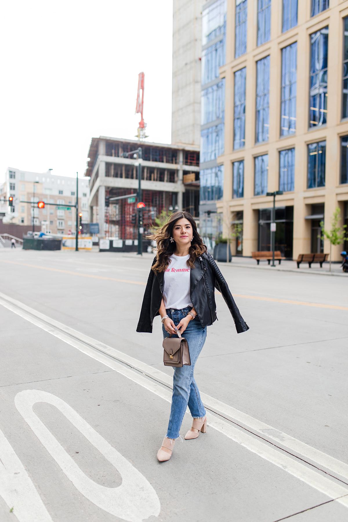 Carolina Hellal of Chic Talk wearing la femme t-shirt via Sezane, Levi's 501 straight vintage jeans, nude mules and topshop black faux leather jacket