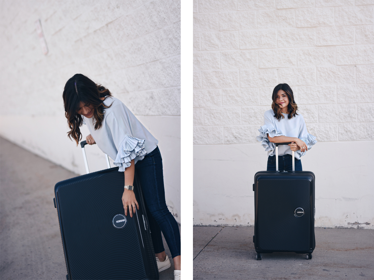 Carolina Hellal of Chic Talk and an American Tourister curio black bag