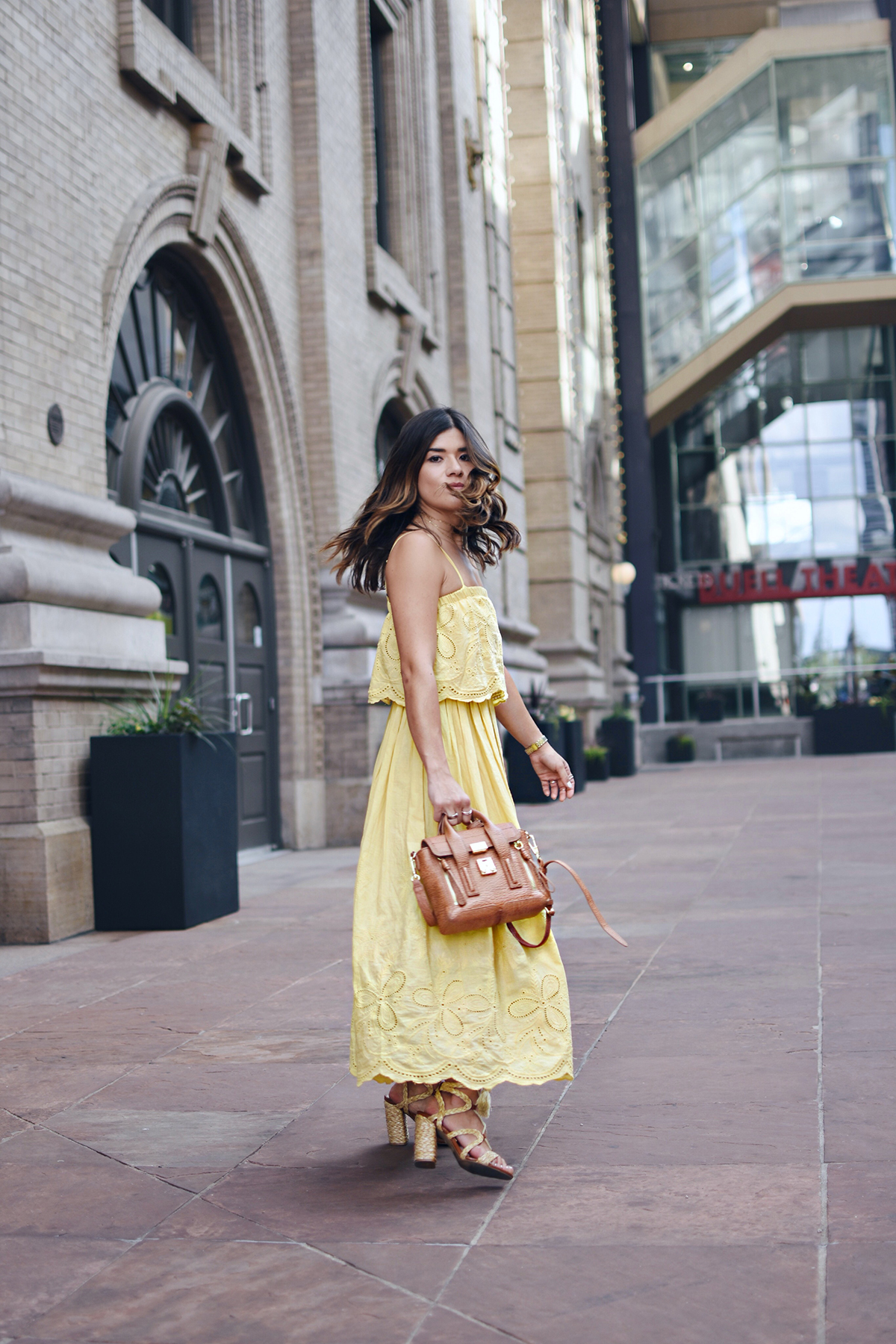 Carolina Hellal of Chic Talk wearing a Chicwish maxi yellow dress, MIA sandals, Argento vivo chockers and Phillip Lim satchel bag