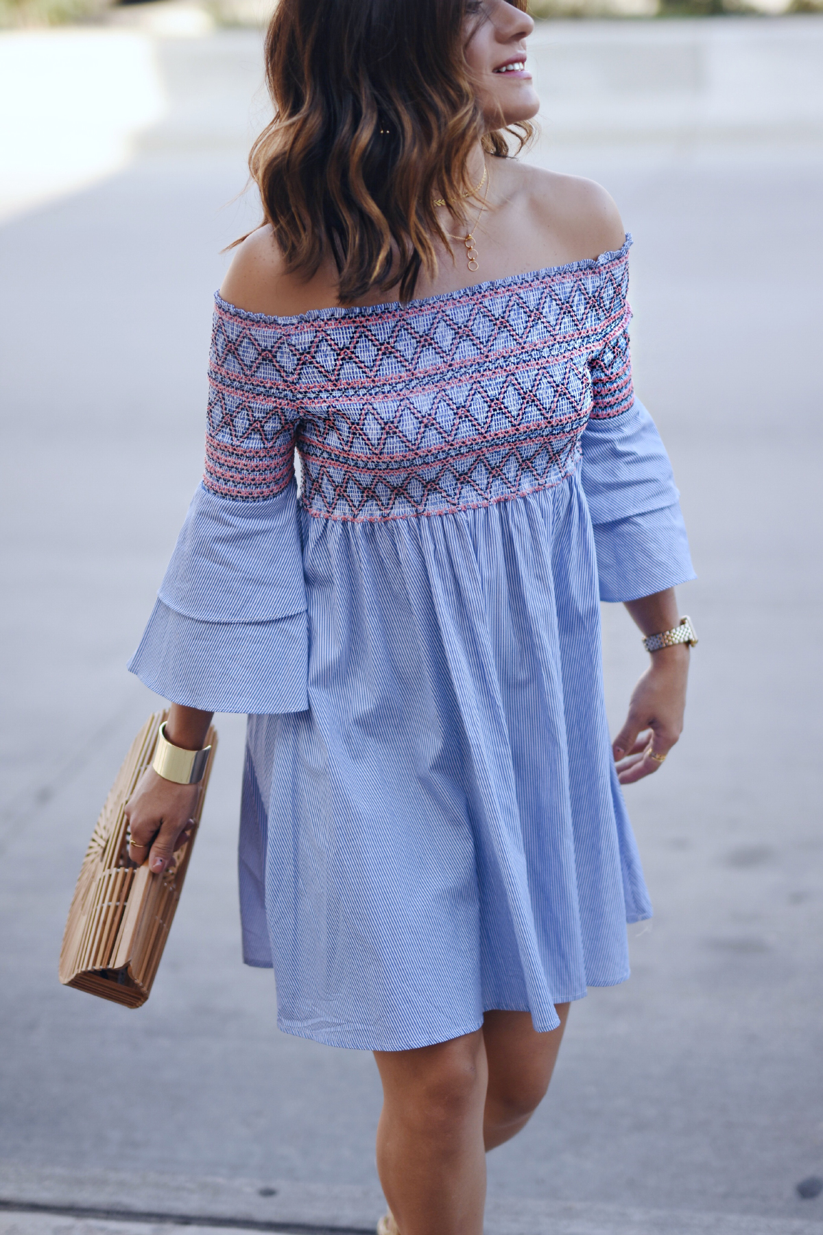 Carolina Hellal of Chic Talk wearing a Chicwish off the shoulder dress, wick lace up sandas, Cult gaia Ark bag