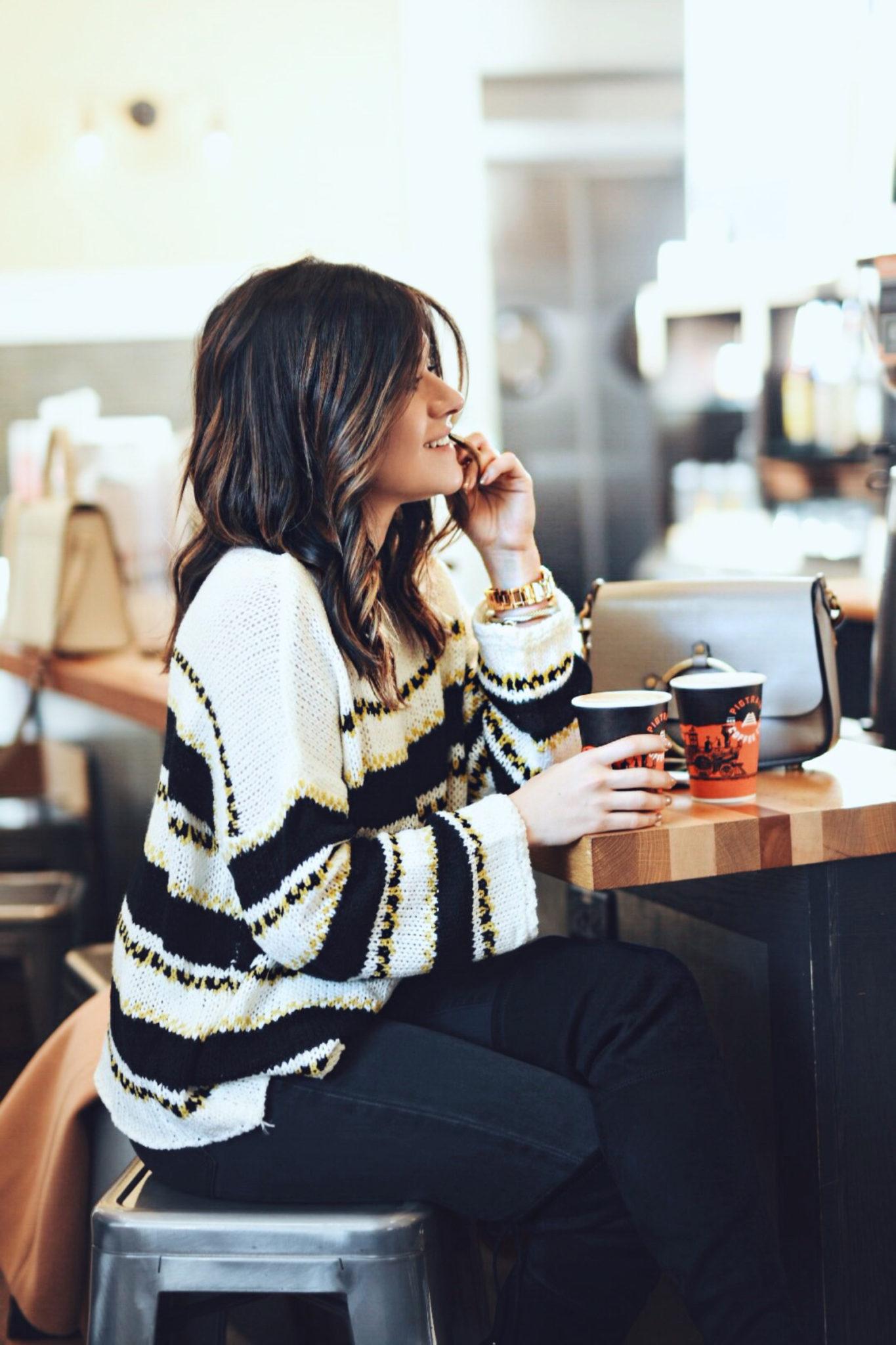Carolina Hellal enjoying a cup of coffee at PigTrain Coffee