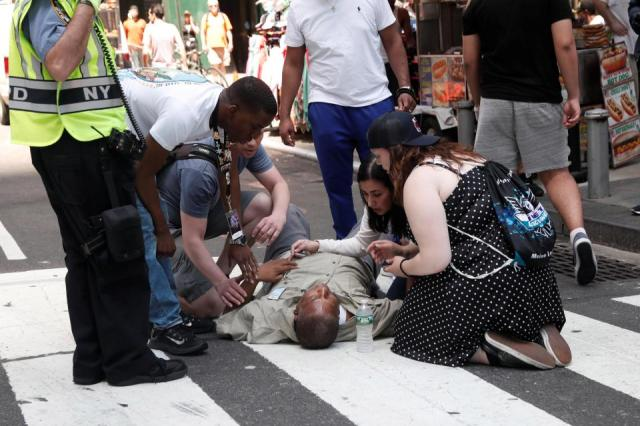 PHOTOS: Times Square chaos as speeding car ploughs into crowds leaving girl, 18, dead and injuring 22 others