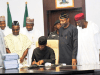 Acting President Yemi Osinbajo Signs 2017 Budget In Law