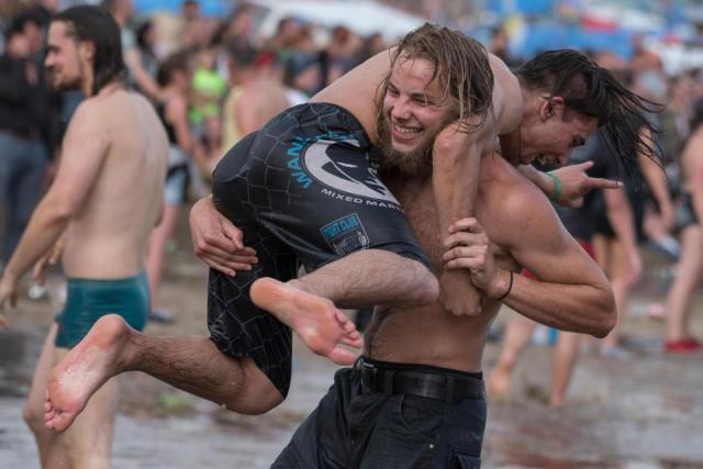 Girls wrestle dirty in muddy water at Woodstock music festival in Poland