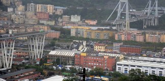 Twenty two killed including a baby and dozens more feared dead as huge section of highway bridge collapses as cars drive across it in 'apocalyptic scene' during fierce storm in Genoa