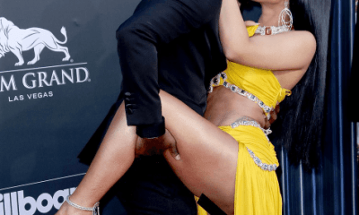 Cardi B nearly exposes her private part as lifts her leg while posing with Offset at Billboard Awards (Photos)