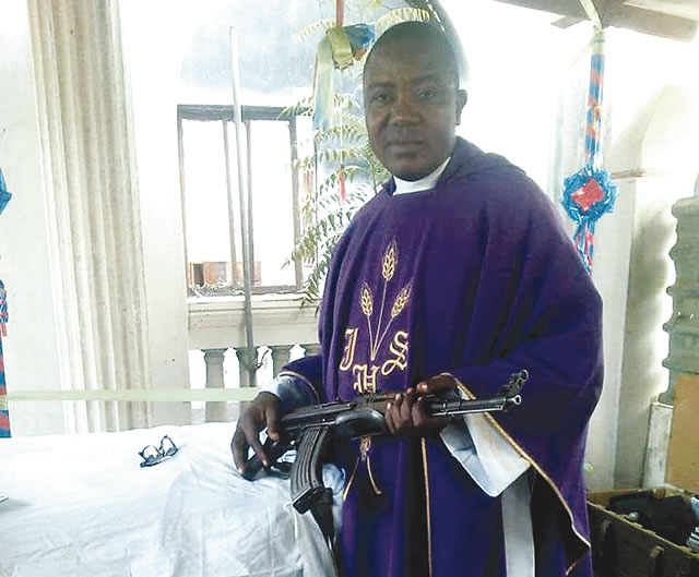 photo-depicting-a-clergyman-dressed-in-a-purple-and-white-cassock-with-a-rifle-cradled-in-his-arms-has-gone-viral