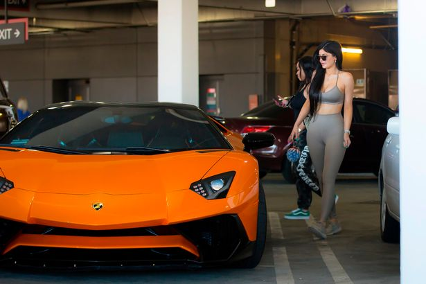 PAY-EXCLUSIVE-Kylie-Jenner-competes-with-her-new-Lamborghini-in-Nude-Outfit (1)