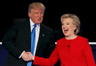 Donald Trump shakes hands with Hillary Clinton at the conclusion of their first presidential debate.