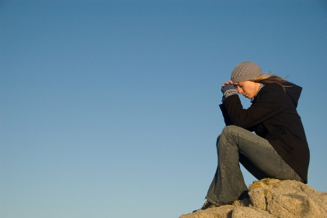 woman praying outside - Prayer Is A Conversation- Today's Billy Graham Daily Devotional