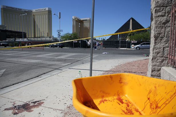 Police have cordoned off the street with blood on display (Image: REX/Shutterstock)