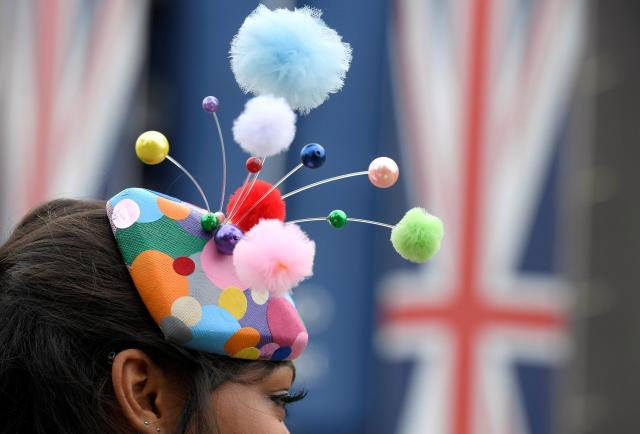 Quirky headpieces were spotted on many racegoers, including this multi-coloured pom pom fascinator