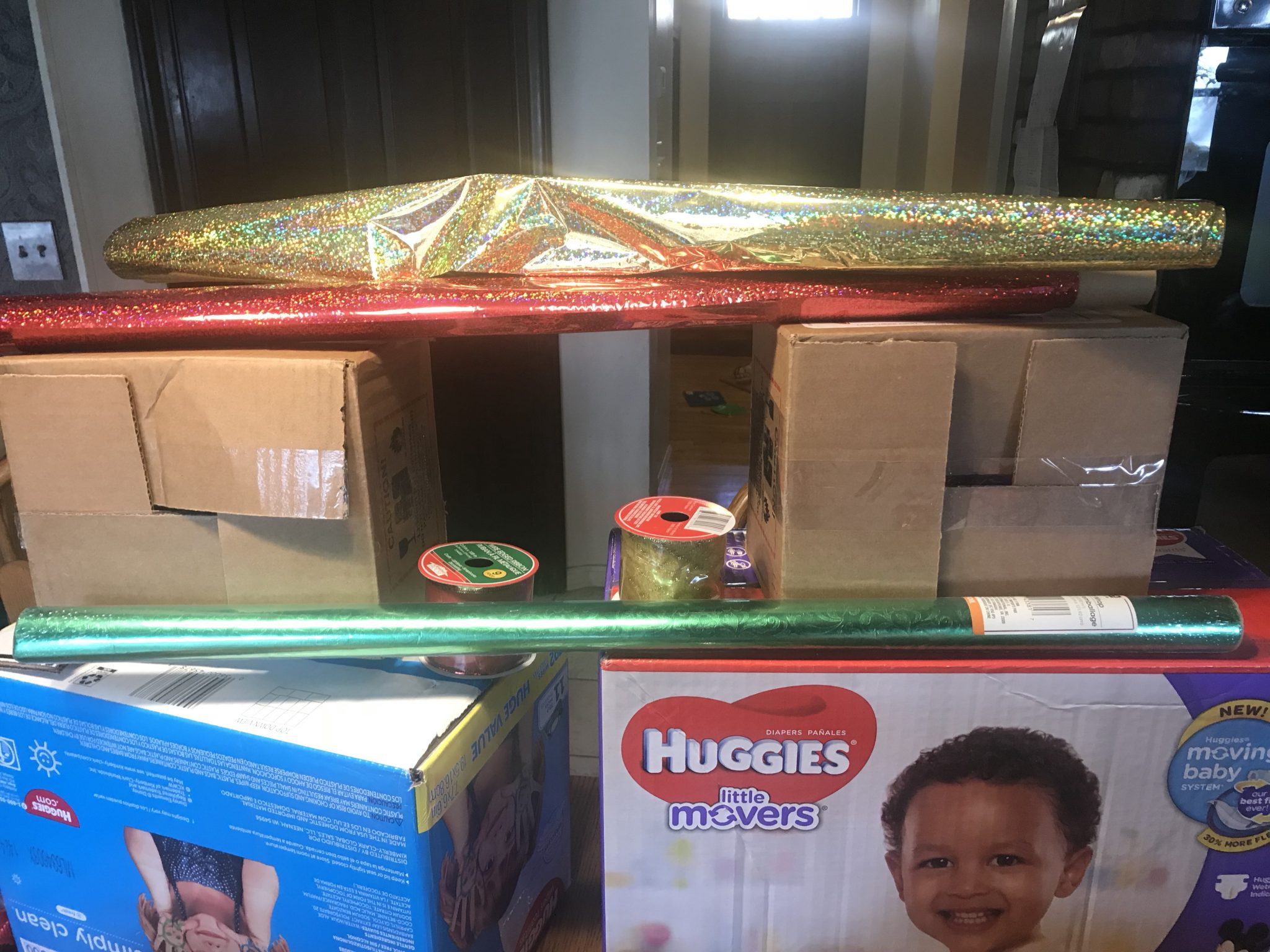 Boxes and dollar store wrapping paper