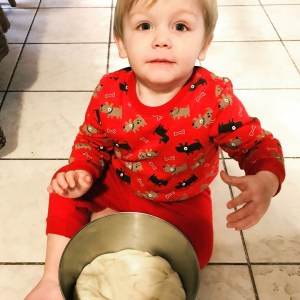 This little guy isn't thinking about identity thieves while helping mom cook in his puppy pajamas.