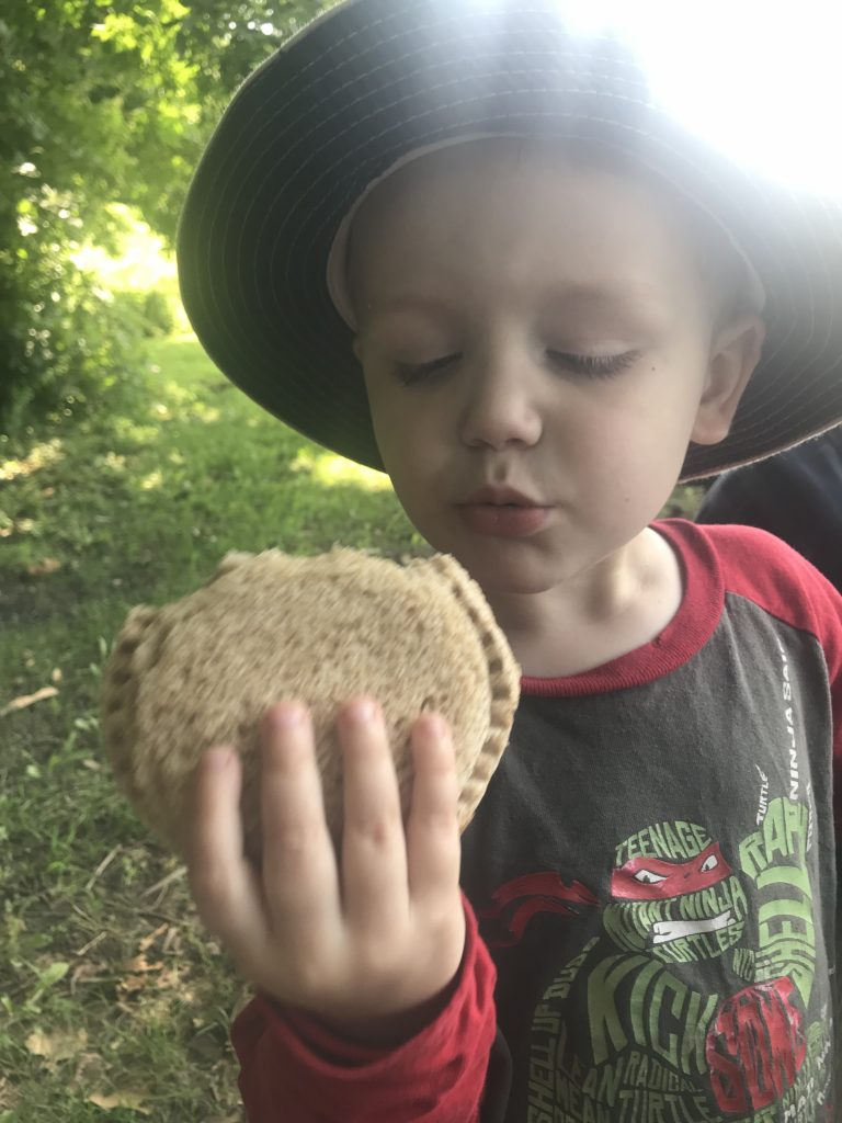 """Alex eating a homemade """"Peanut butter jelly pie"""", as we call them, while on a trip to a castle."""