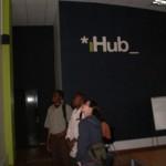 ACORN International organizers with matatu map and iHub wall