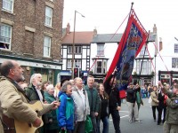 Billy Bragg singing with 'Cotia Pit folk group at Durham Miners Gala, a 120-year-old festival in which mining communities from all over County Durham (the largest coalfield in Britain; there have been 218 pits in Durham County over the years) march with banners and bands to the centre of the town 2004.