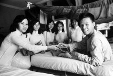 Students from Saigon's Gia Long Highschool visit wounded soldiers in Cong Hoa Military Hospital. Nov 1963