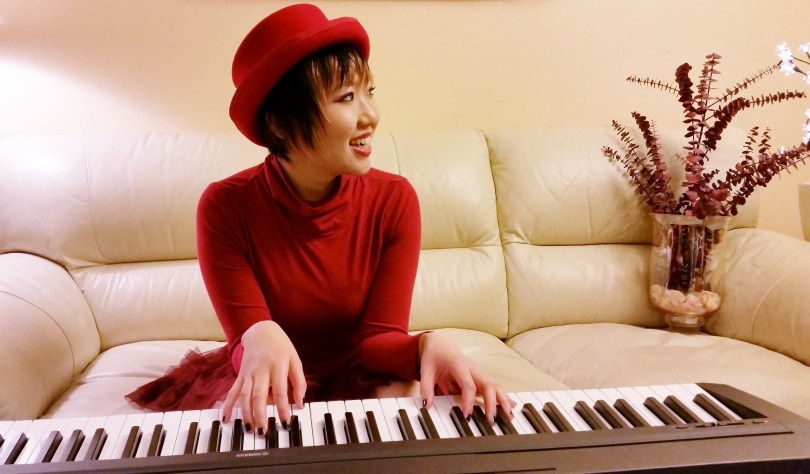 Chihiro profile photo wide keyboard piano red hat red dress white sofa playing piano
