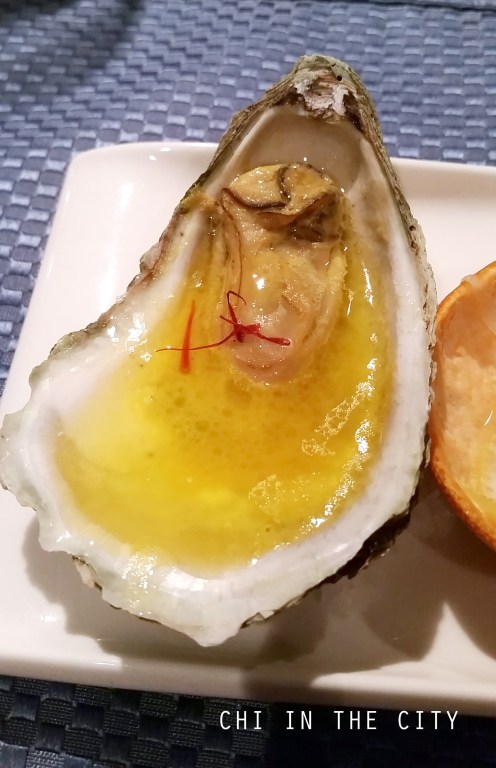 Poached Oyster in Butter Champagne and Saffron