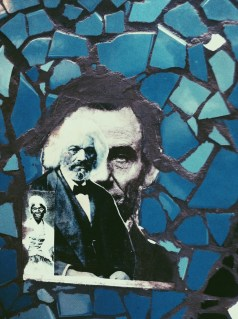 Abe on a mural at the Orozco Community Academy