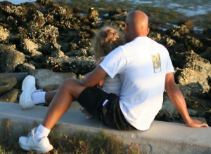 father comforts daughter