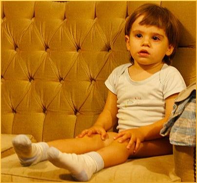 kid-on-yellow-sofa-watching-tv