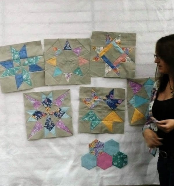 Putting my sampler blocks and some hexies on the design wall at the BMQ Guild Meetup in October