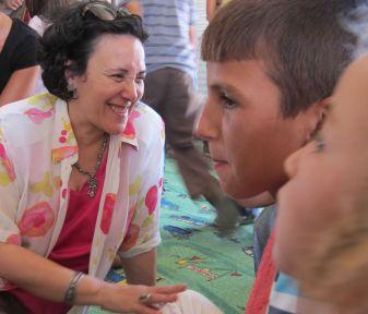 Leila Zerrougui talks to children at Zaatari camp in Jordan. Copyrights: Stephanie Tremblay/ OSRSG-CAAC