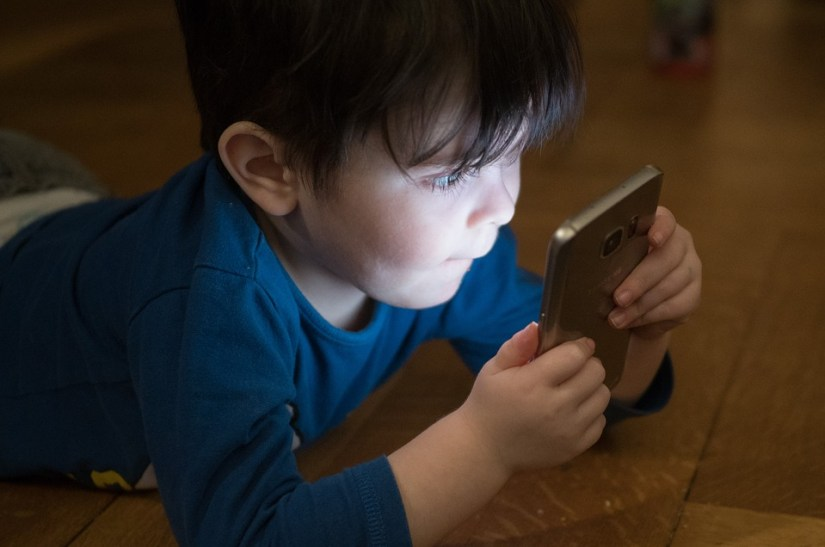 child with a phone
