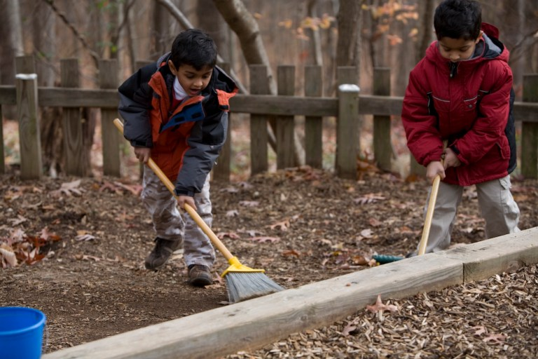 sweeping and raking in the a natural play space