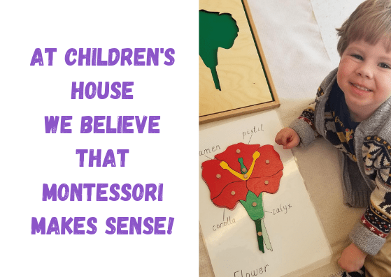 Child smiling proudly at Children's House Montessori School of Reston