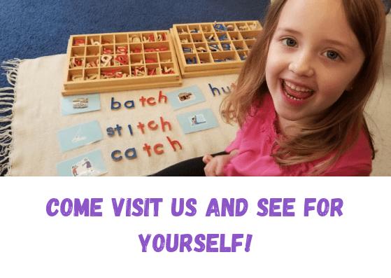 Child smiling at Children's House Montessori School of Reston