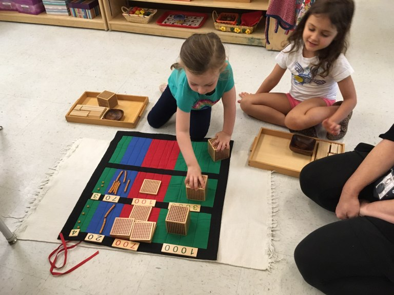 Two children work together. Teaching Character Development in Early Childhood