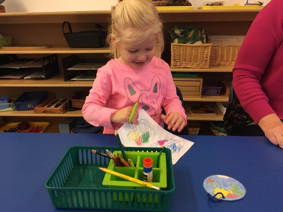 child using art materials