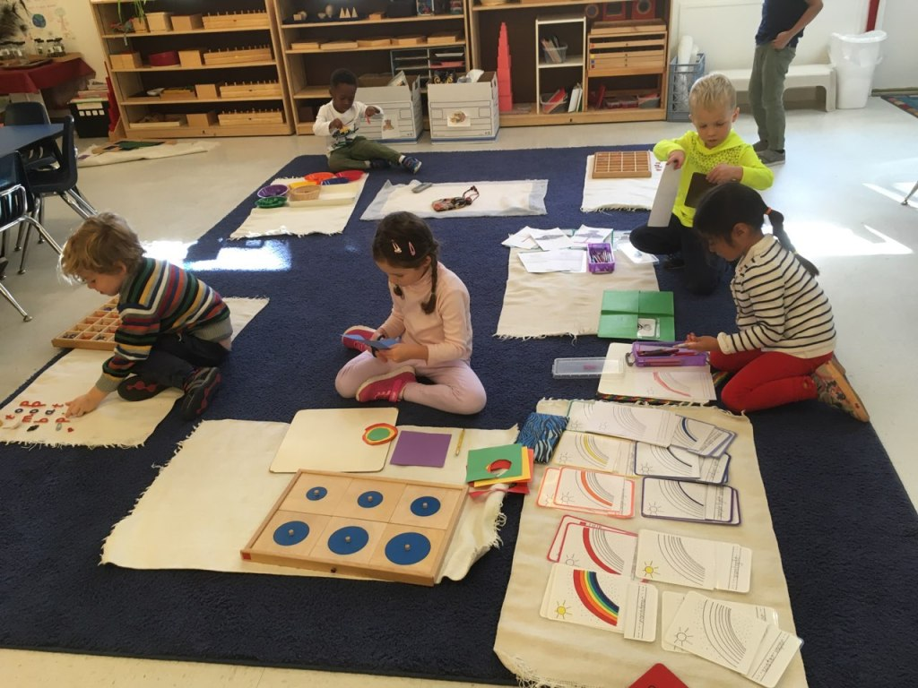 Children working at Children's House Montessori School of Reston