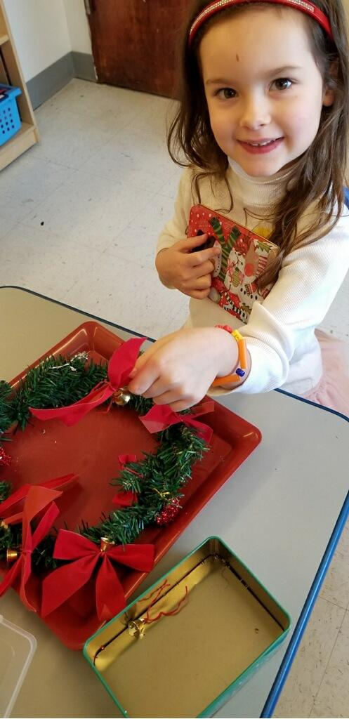Child smiling with Christmas wreath / things to say instead of good job