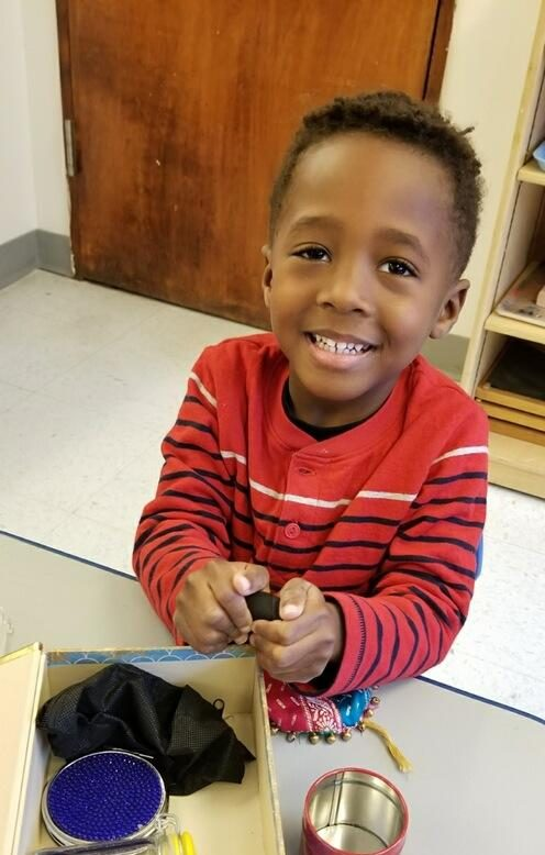 Child using opening and closing materials.